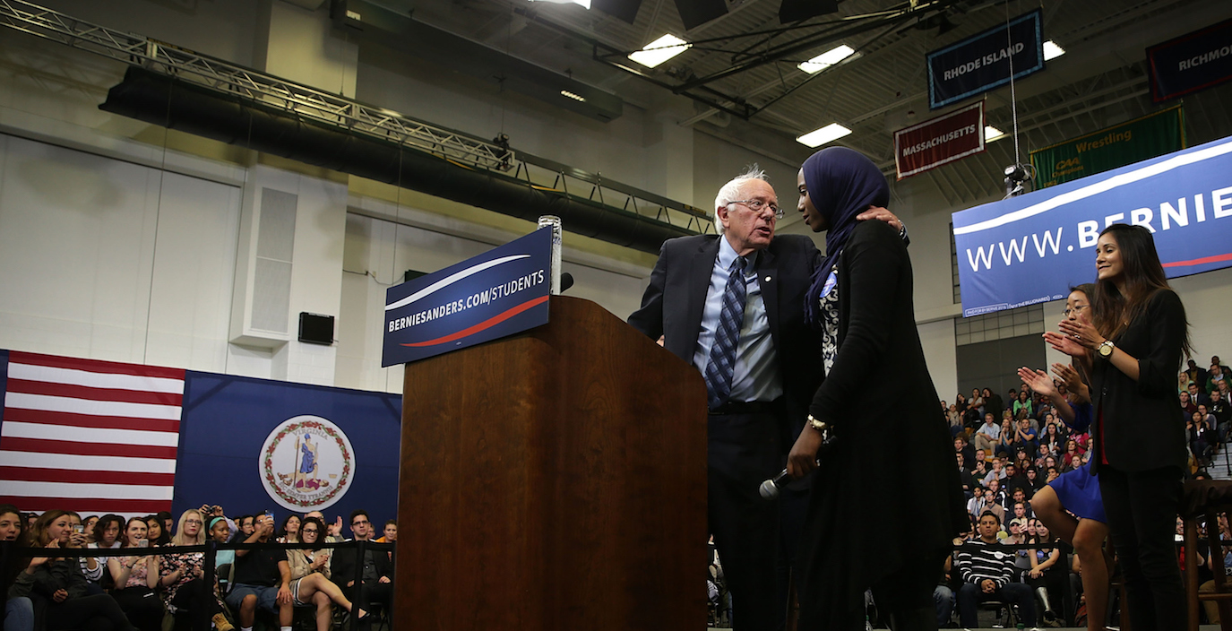 "FAIRFAX, VA - OCTOBER 28:  Democratic presidential candidate and U.S. Sen. Bernie Sanders (I-VT) hugs Muslim student Remaz Abdelgader during a ""National Student Town Hall"" at George Mason University October 28, 2015 in Fairfax, Virginia. Sen. Sanders continued to campaign for the Democratic nomination.  (Photo by Alex Wong/Getty Images)"